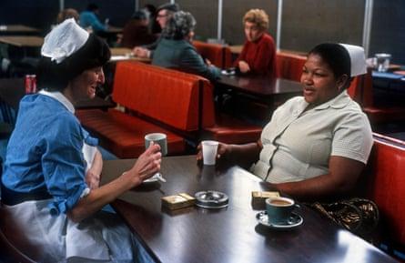 Two nurses enjoying a cup of tea.