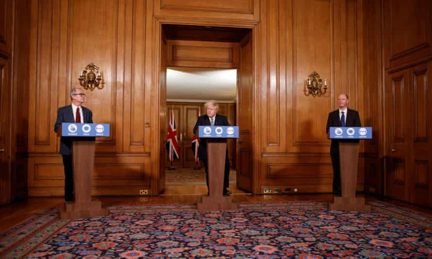 Prime minister Boris Johnson alongside chief medical officer Chris Whitty and chief scientific adviser Patrick Vallance, at a news conference on Covid-19 on 26 November.
