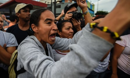 Residents of the Catia low-income neighbourhood rally to protest against the lack of food in Caracas on Tuesday.