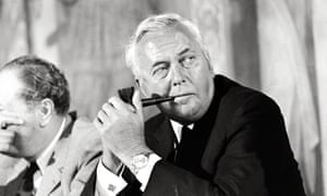Harold Wilson in a meeting, smoking a pipe