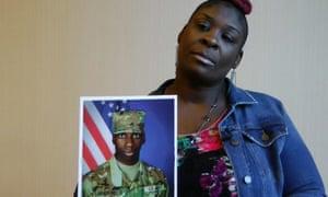April Pipkins holds a photograph of her deceased son, Emantic 'EJ' Bradford Jr in Birmingham, Alabama on 27 November 2018.