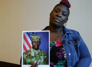 April Pipkins holds a photograph of her deceased son, Emantic 'EJ' Bradford, during an interview in Birmingham, Alabama.