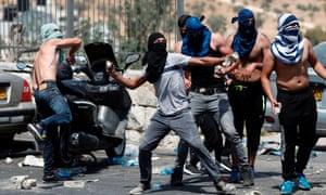 Palestinians throw rocks