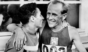 1952: Zatopek, with his friend, the French runner Alain Mimoun, who finished second to him in the Helsinki Olympic Games 5k.