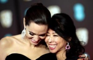 Angelina Jolie arrives with Loung Ung, the Cambodian-American human-rights activist. Jolie's film adaptation of Ung's book, First They Killed My Father, is nominated in the Best film Not in the English Language