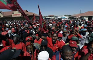 Members of the Economic Freedom Fighters protest outside the magistrates court where two suspects were to appear on charges of killing a white farmer in the area of Senekal, South Africa