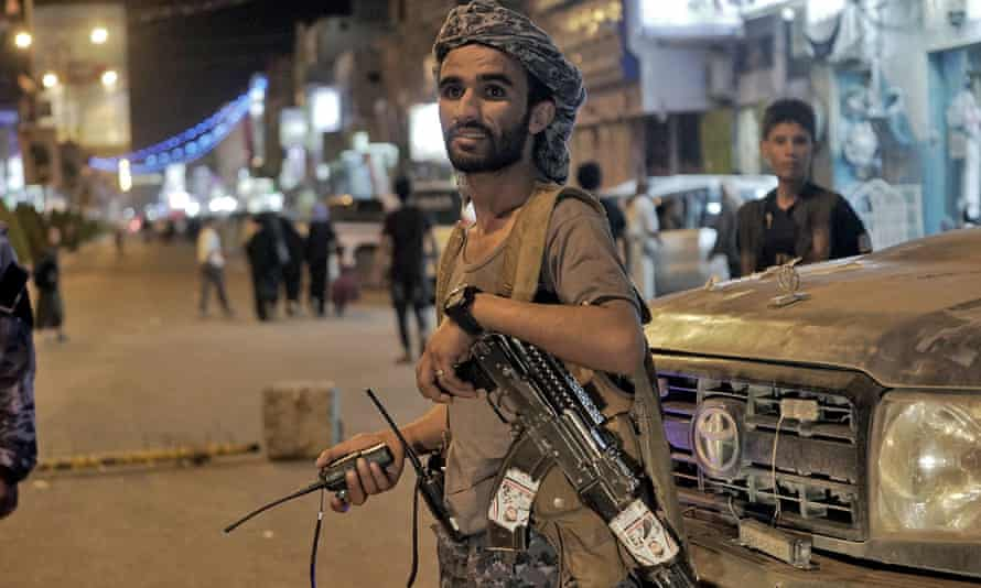 Fighters loyal to Yemen's Saudi-backed government stand guard at the entrance of the north-eastern city of Marib