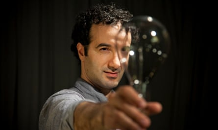 Jad Abumrad from Radiolab with a lightbulb