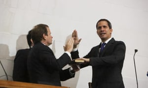 Guaidó takes the oath inside the parliament building.