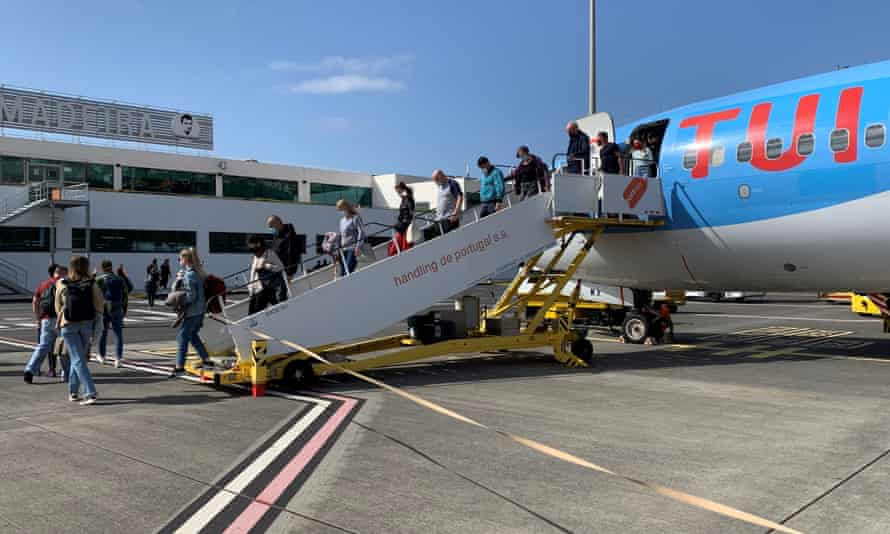 Passengers disembark from a UK flight to Madeira on Monday.