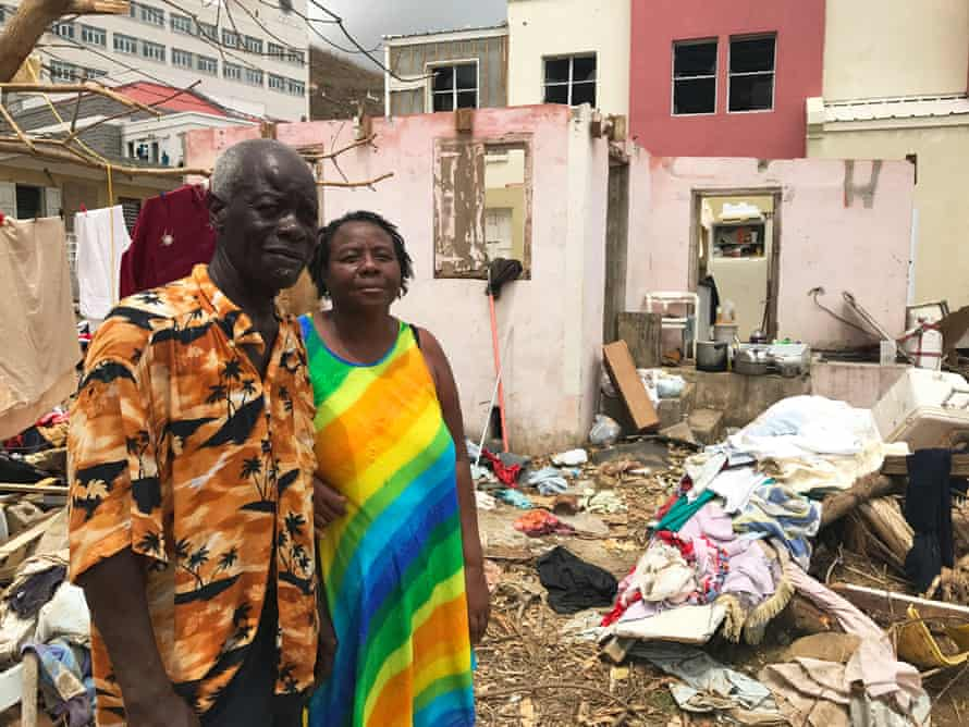 Dorothy and Alvin Nibbs stand by their destroyed home in Tortola.