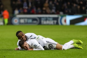 Bersant Celina of Swansea City celebrates scoring his team's third goal with Leroy Fer as The Swans beat Gillingham 4-1 at The Liberty Stadium. Swansea have now reached the last 16 of the FA Cup in consecutive seasons for the first time since 1964-65.