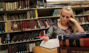 Student working in library.