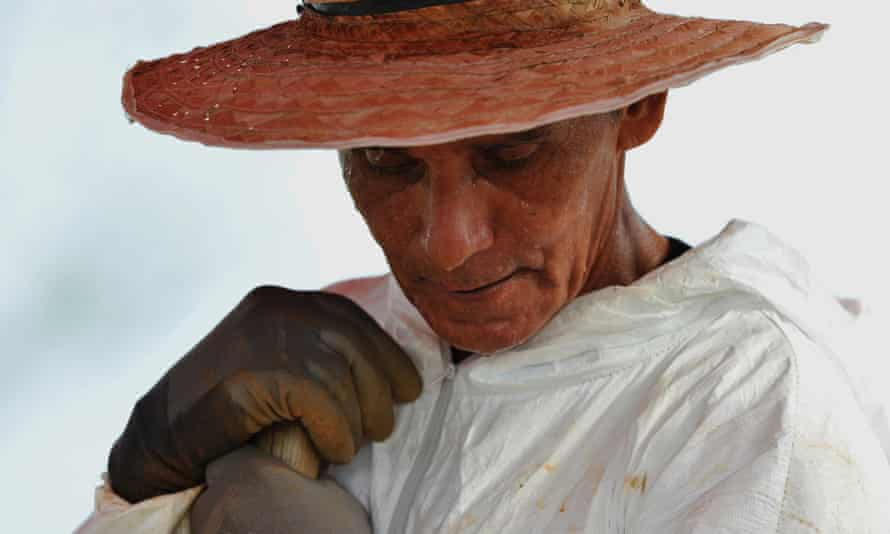 Jesus Hernandez, the gravedigger of the cemetery, takes part on the exhumation of unidentified bodies at La Macarena, Colombia.