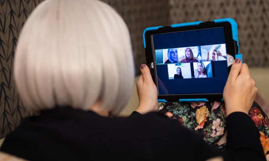 A group of women use the Zoom video conferencing application