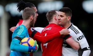 Mitrovic and de Gea clash.