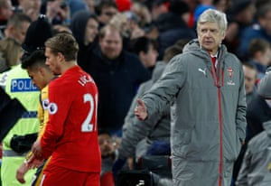 Alexis Sanchez and Lucas Leiva walk past Arsene Wenger at the end of the match.
