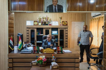 Jalawla's mayor, Yacop Yusef, in his office, where he has an armed bodyguard and soldiers outside.