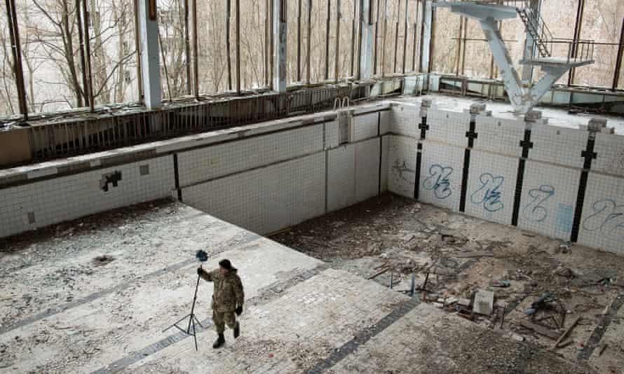Michał Grzesiczek takes photos for a Chernobyl virtual reality project.