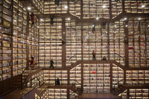 Shaoyang, China – Readers peruse the vast collection at Shaoyang library in Hunan, which has a mirrored ceiling.