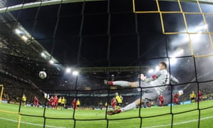 Dortmund's Marco Reus scores from the spot.