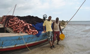 Fishermen Omar Mohamed (R) and Haji Shame at Gazi Bay ready to sail out to sea
