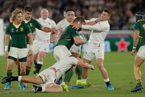 South Africa's Duane Vermeulen pushes Jonny May in the throat as he is tackled by Sam Underhill.