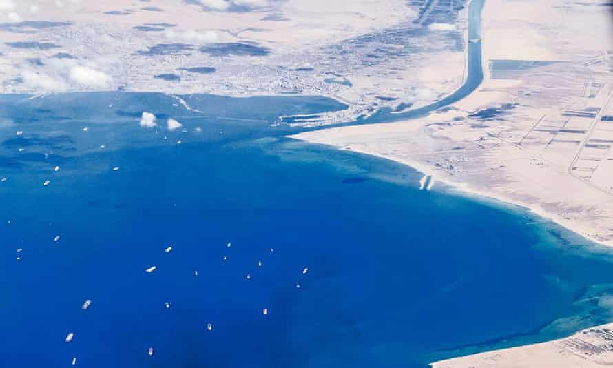 An aerial view on March 27 shows ships waiting in queue in the Gulf of Suez .