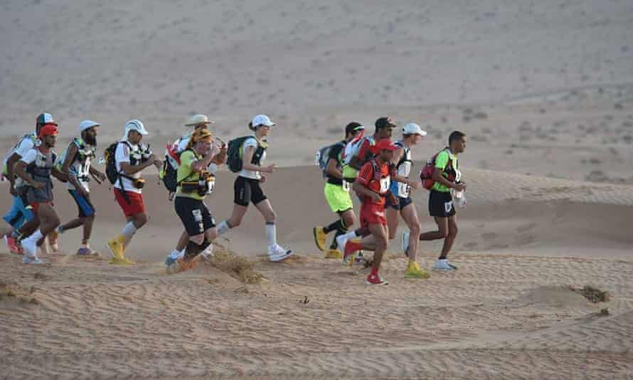 Barnes (6th from right) in action in the Oman Desert Marathon.