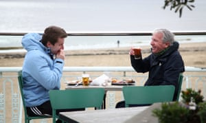 Beer on the seafront, in coats