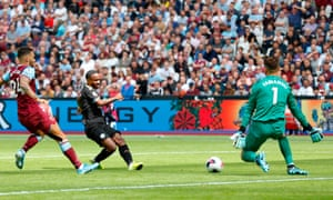 Manchester City's Raheem Sterling slots home their second goal.