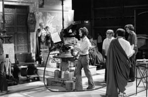 A production shot showing cameramen filming a scene from episode 8 of 'I, Claudius' in 1976. Left to right, Patrick Stewart as Sejanus, Ian Perry on the camera, Herby Wise, the director (in the white T-shirt) and crew member Martin Kempton