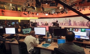 Staff work inside Al Jazeera HQ in Doha
