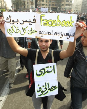 An Egyptian holds up a sign praising Facebook, joining others in Cairo's Tahrir Square in February 2011.