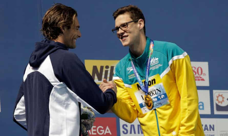 Mitch Larkin shakes hands with Camille Lacourt of France after winning the 100m backstroke final on day three in Kazan.