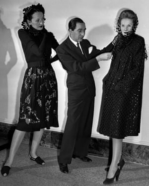 Norman Norell, the brilliant Indiana-born designer, displays two creations at the Metropolitan Museum of Art in 1943.