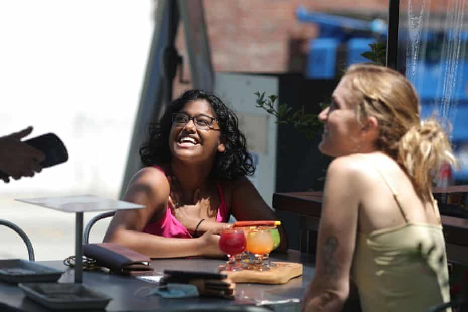 Upekshila Wickett, 26, and Valerie Grant, 26, drink margeritas at a restaurant in Santa Monica.