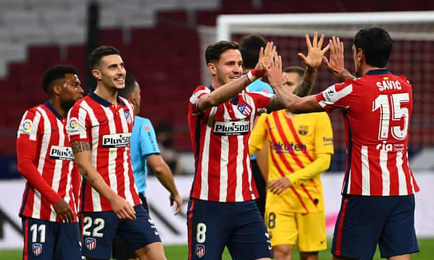 Atlético Madrid players celebrate after the 1-0 win over Barcelona.