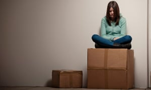 Teenage girl sitting on cardboard box