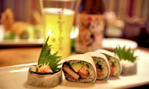 Plate of hand rolls and a beer at Tomo Sushi, Amsterdam, the Netherlands.