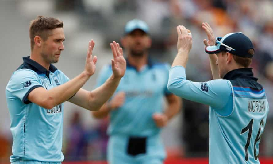 Chris Woakes celebrates dismissing New Zealand's Tom Latham with Eoin Morgan during Sunday's World Cup final
