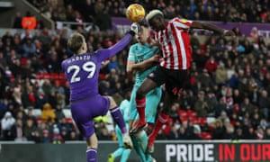 Benjamin Kimpioka heads the fourth goal to seal Sunderland's victory.