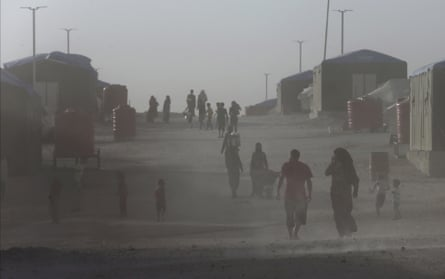Civilians from Raqqa, who fled fighting between US-backed Syrian Democratic Forces and Islamic State militants, in a dusty refugee camp.