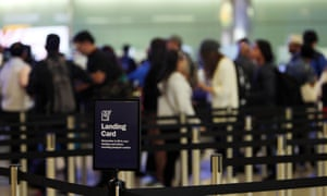 Passengers going through UK border control at Heathrow airport