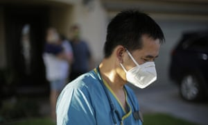 Dr Tien Vo wearing PPE after talking with a family quarantining after they tested positive for coronavirus in California in July 2020.