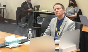 Derek Chauvin listens as his defense attorney Eric Nelson gives closing arguments.
