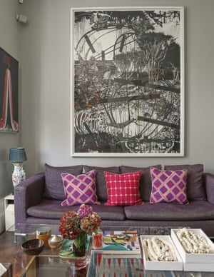 Bright fabrics and West African art in the sitting room.