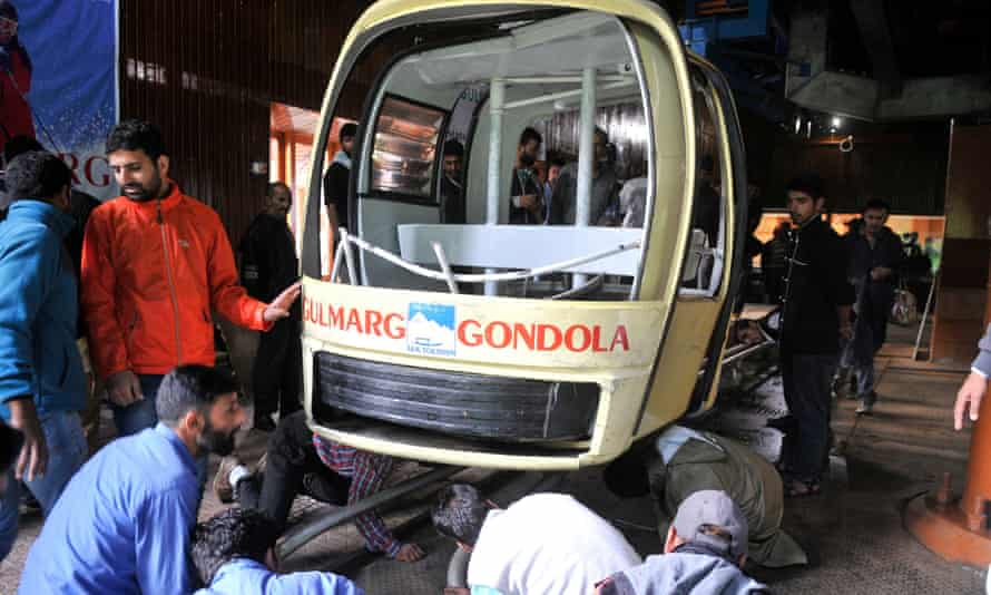 People inspect a section of the cable car which collapsed at Gulmarg, northwest of Srinagar, the summer capital of Indian Kashmir.