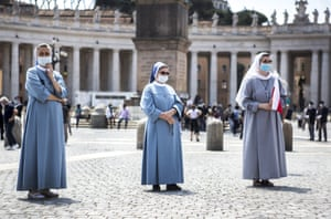 Nuns and Faithfuls attend the Regina Caeli Sunday prayer in the reopened St. Peters Square at the Vatican on May 24, 2020 in Rome, Italy.