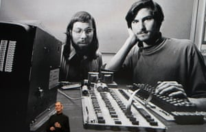 Steve Jobs speaks during an Apple event in 2010 – with a photo of him and Steve Wozniak in the background.
